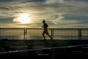 150101-N-JP249-034 ATLANTIC OCEAN (Jan. 1, 2015) A Sailor aboard USNS Spearhead (JHSV 1) jogs across the ship's flight deck, Jan. 1, 2015. Spearhead is on a scheduled deployment to the U.S. 6th Fleet area of operations to support the international collaborative capacity-building program Africa Partnership Station. (U.S. Navy photo by Mass Communication Specialist 2nd Class Kenan O'Connor/Released)